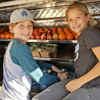 Kids volunteering generation serve mobile loaves and fishes
