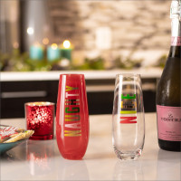 Naughty and nice glasses with sparkling wine