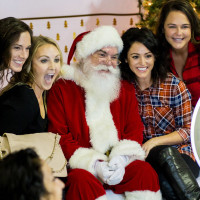 Santa and girls at a photo booth