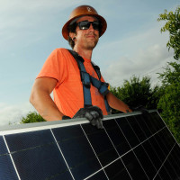 man with solar panels