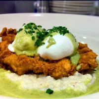 Buttermilk fried chicken with pepperjack grits, jalapeno gravy and poached eggs at Bird Cafe