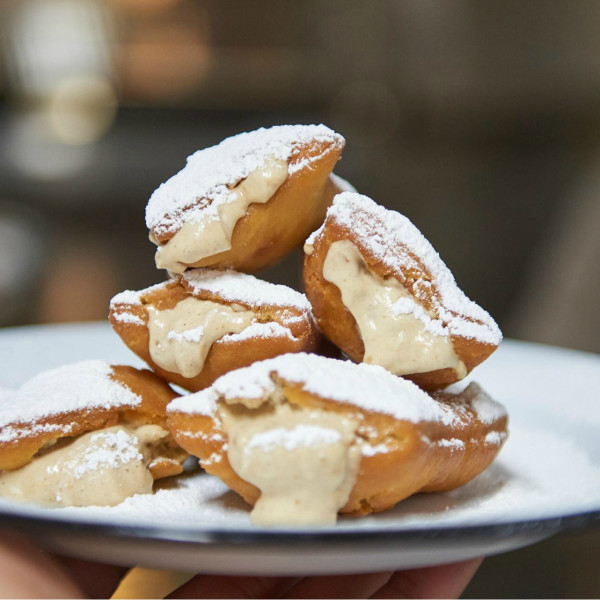 Beignets and Saints march in at New Orleans market-eatery in Arlington