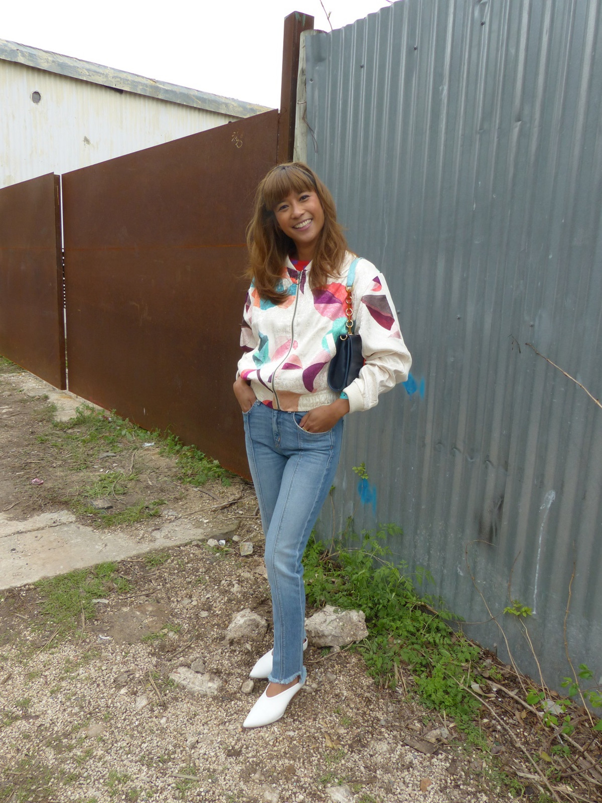 Michelle Rexilius wears a colorful 80's inspired jacket and heeled slip on shoes from Zara in Austin, Texas