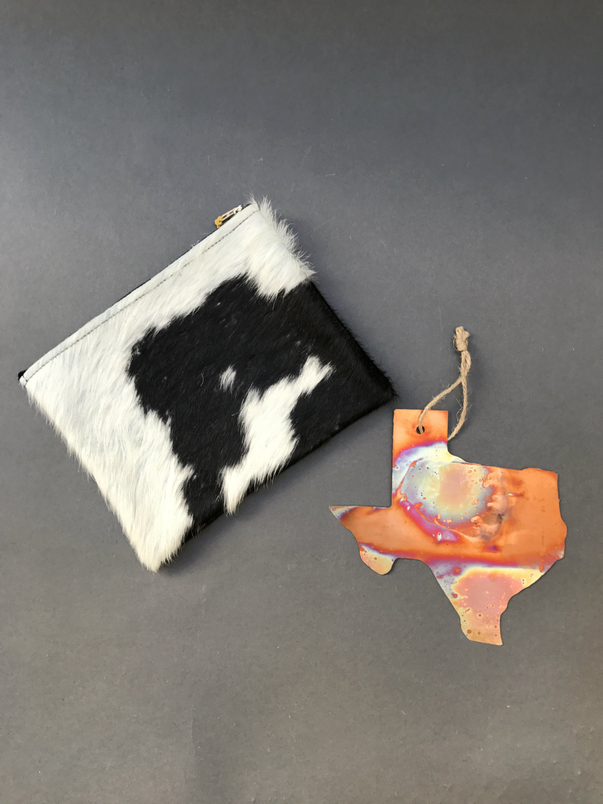 Dallas Antiques Company cowhide pouch and Texas ornament