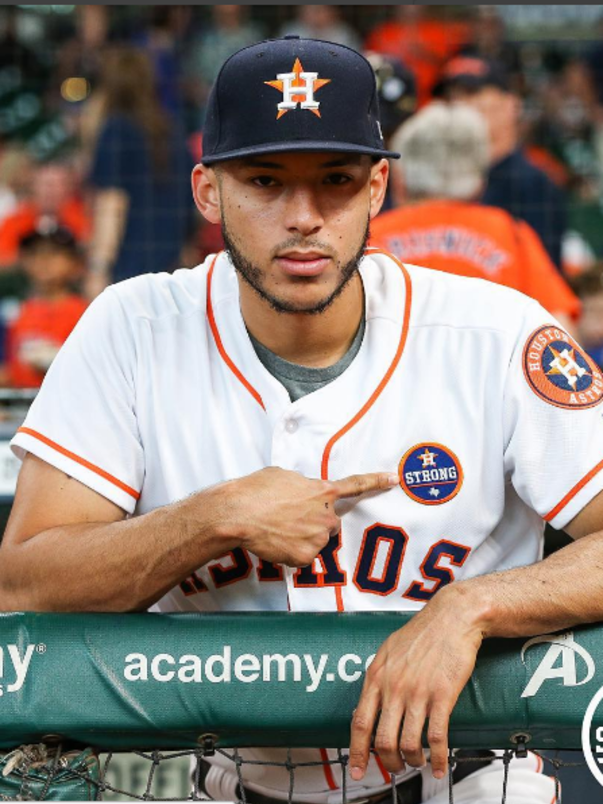 Carlos Correa points out Houston Astros Strong logo