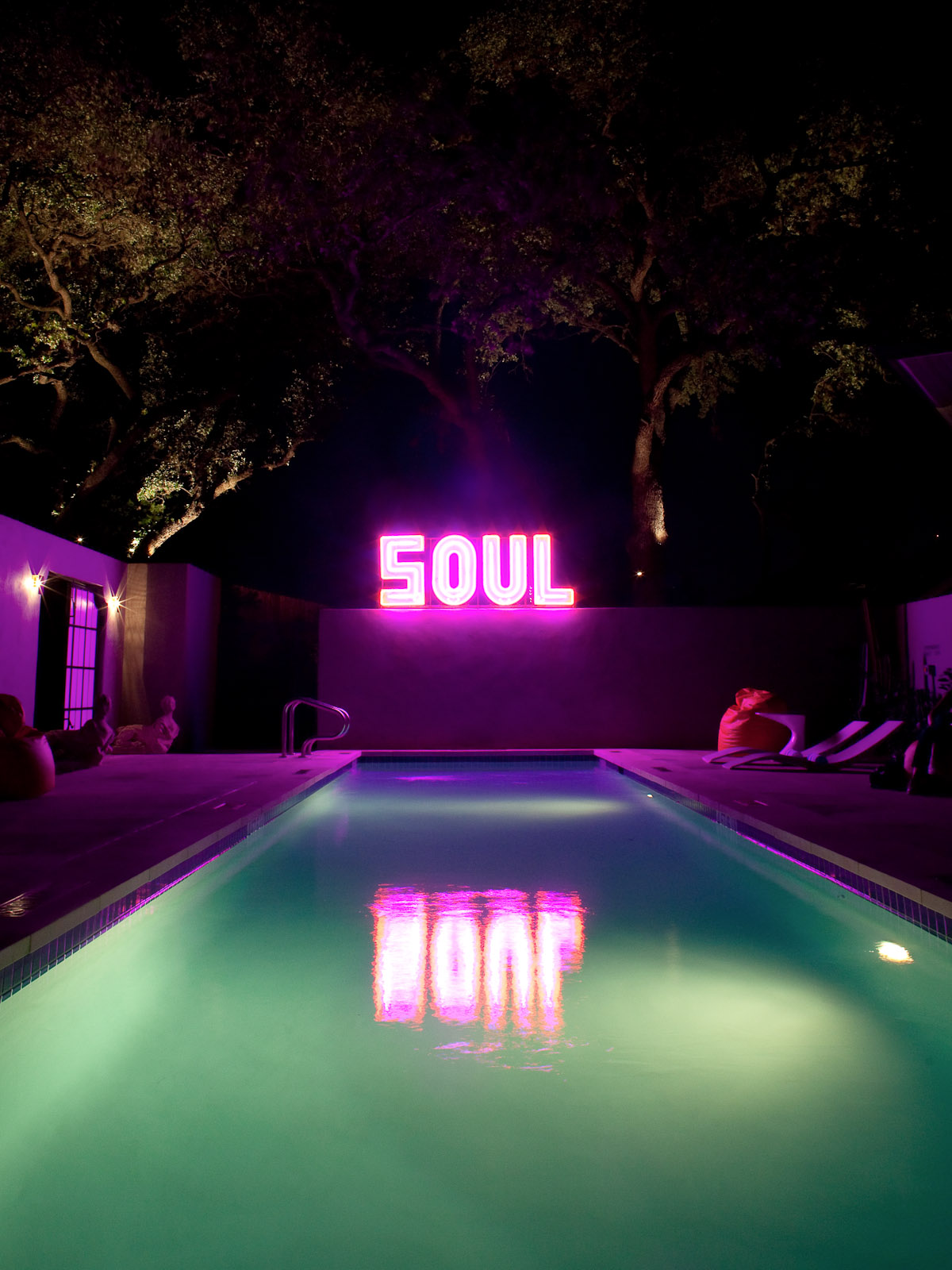 News_Travel_Lonnie Schiller_Hotel Saint Cecilia_pool_neon sign