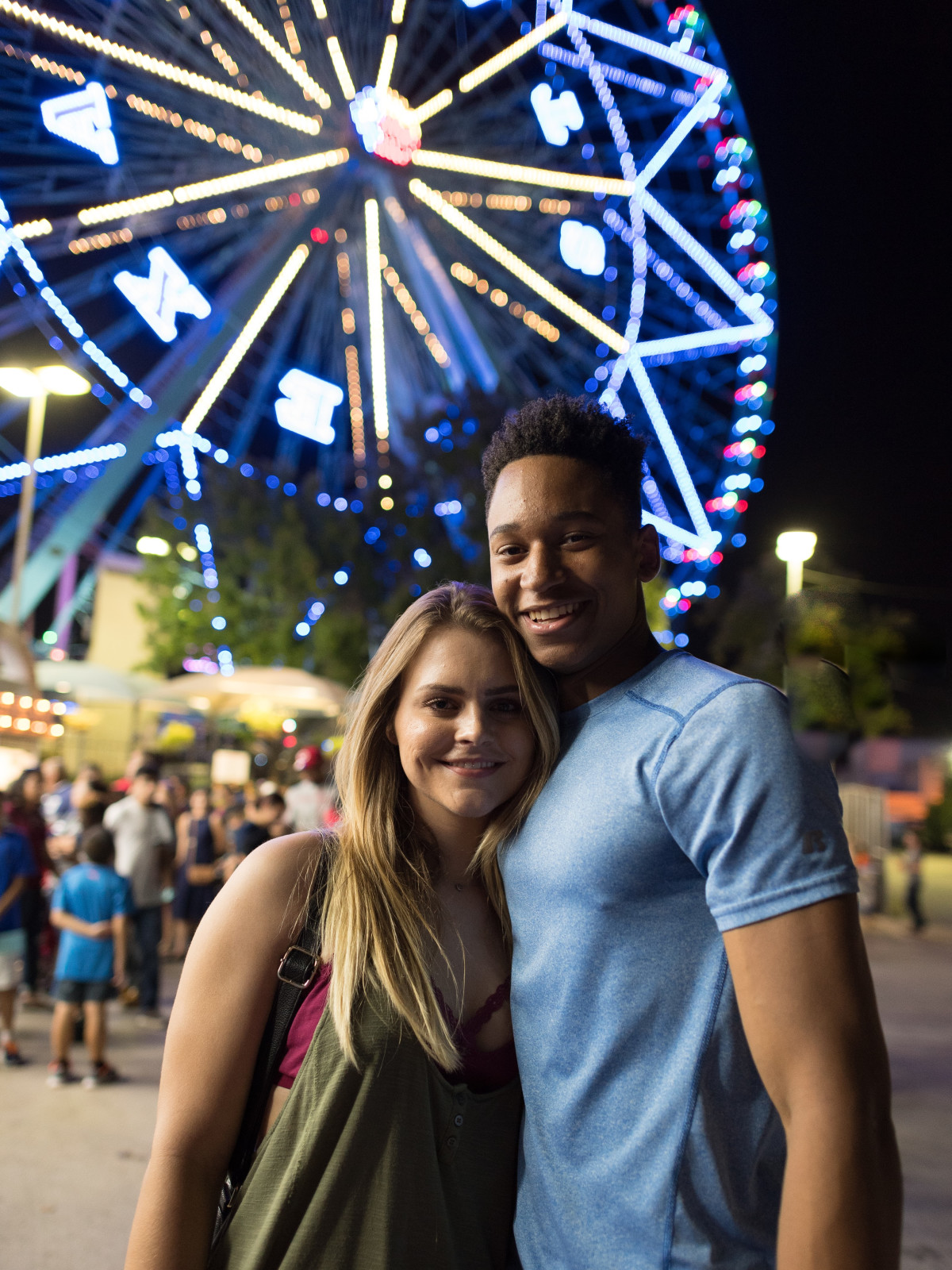 Couple posing in front of the Texas Star Ferris wheel
