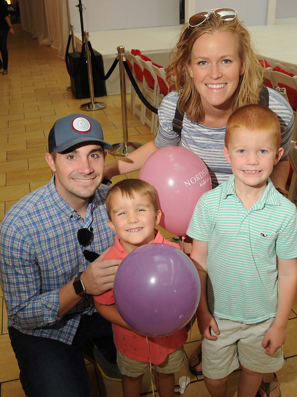 MD Anderson fashion show Steven and Chrissy Kinney with Grayson,7, and Cole,4,