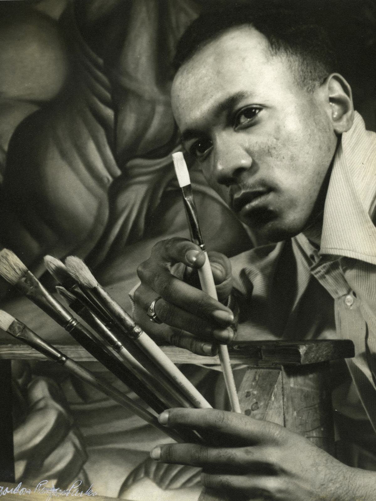 "Charles White in front of his mural ""Chaos of the American Negro,""  Gordon Parks (1912-2006)"