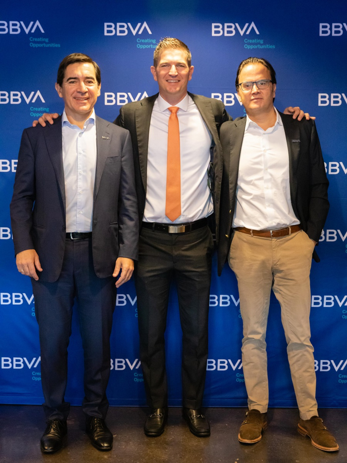 BBVA Group Executive Chairman Carlos Torres Vila (left), Dynamo former player Bobby Boswell (center), and BBVA USA President and CEO Javier Rodriguez Soler (right) at the BBVA Stadium press conference in Houston