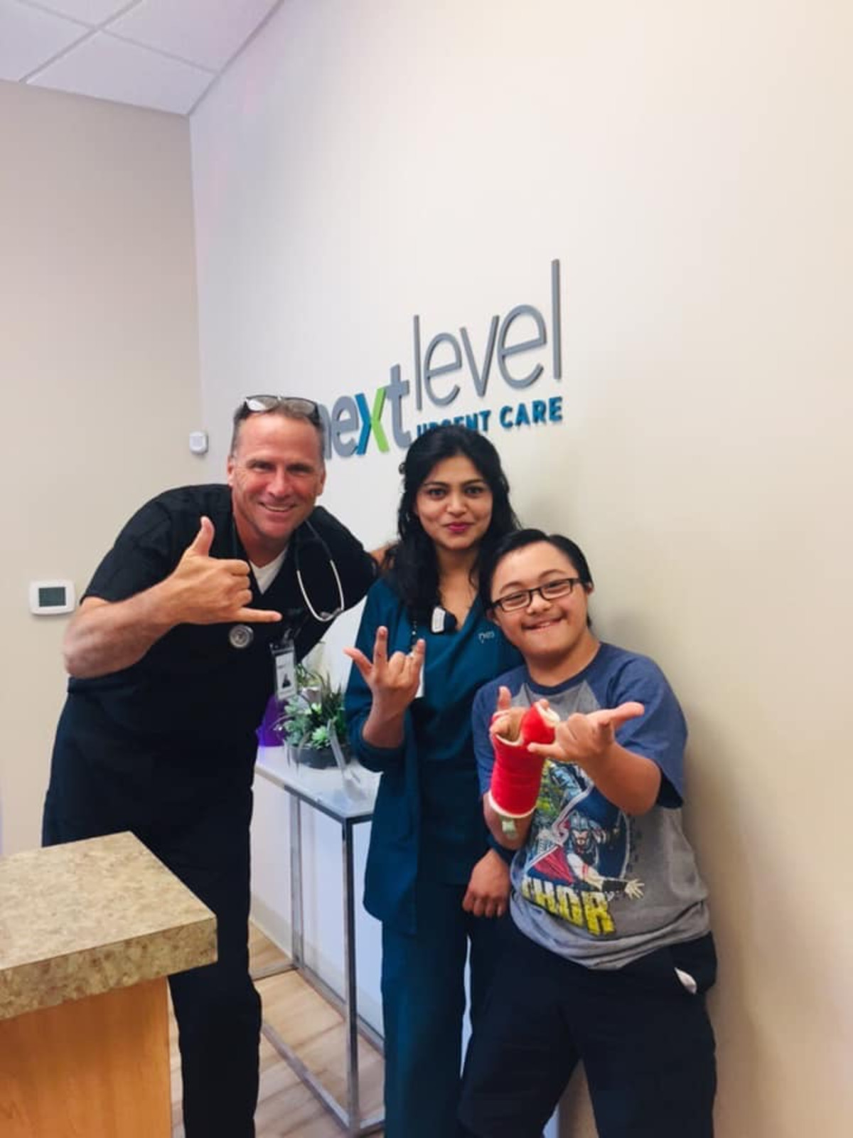 Next Level Urgent Care employees and patient