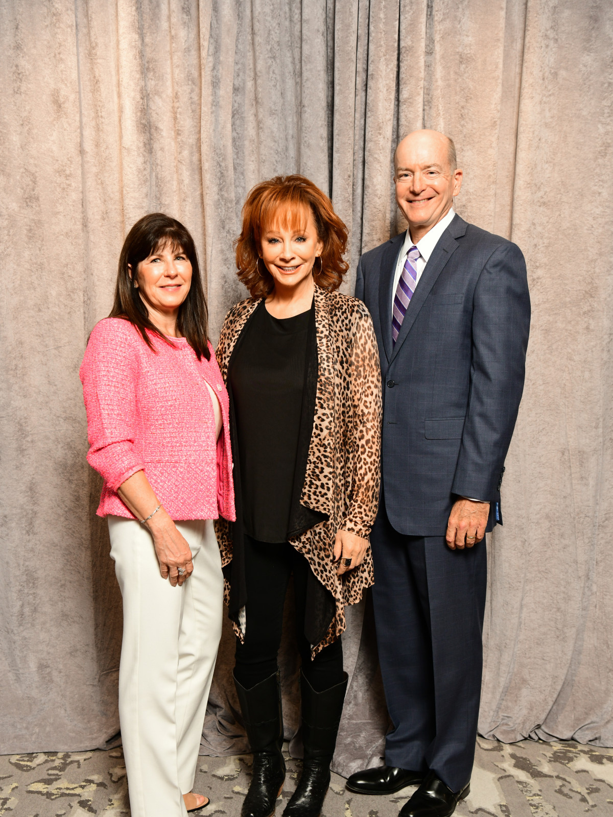 Razzle Dazzle Luncheon 2019 Tonya Callender, Reba McEntire, Dr. David Callender, president and CEO of Memorial Hermann Health System