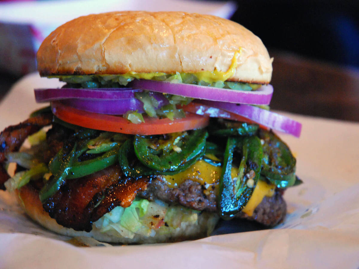 Cheeseburger with bacon and jalapeños at Maple & Motor in Dallas