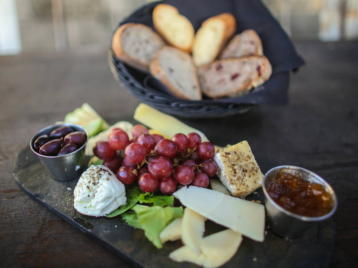 Blue Dahlia Bistro cheese board plate