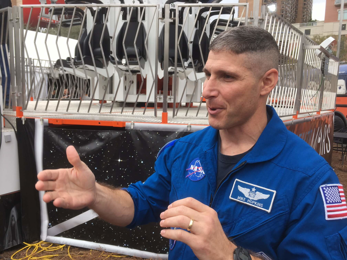 Astronaut Mike Hopkins explains the Future Flight ride at Super Bowl Live