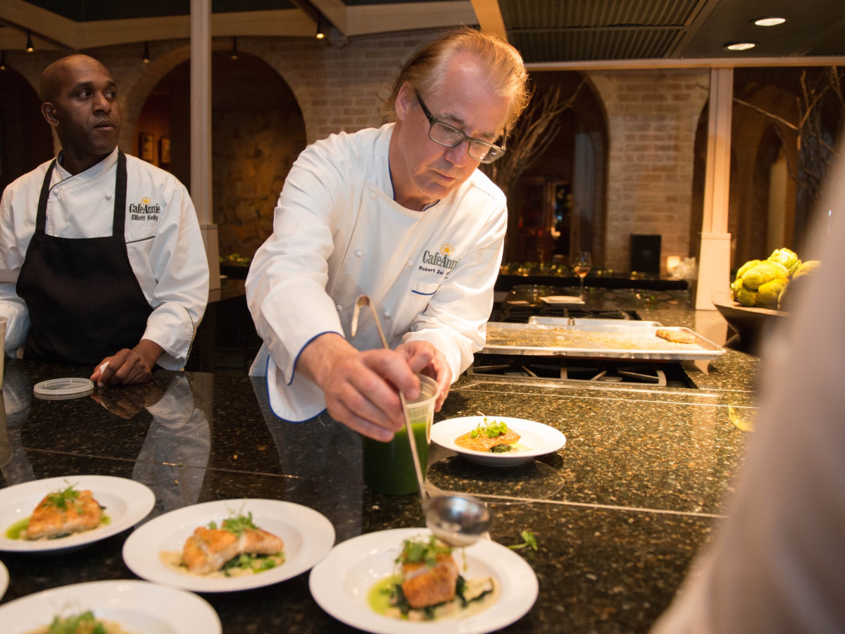 Robert Del Grande in kitchen at Recipe for Success dinner