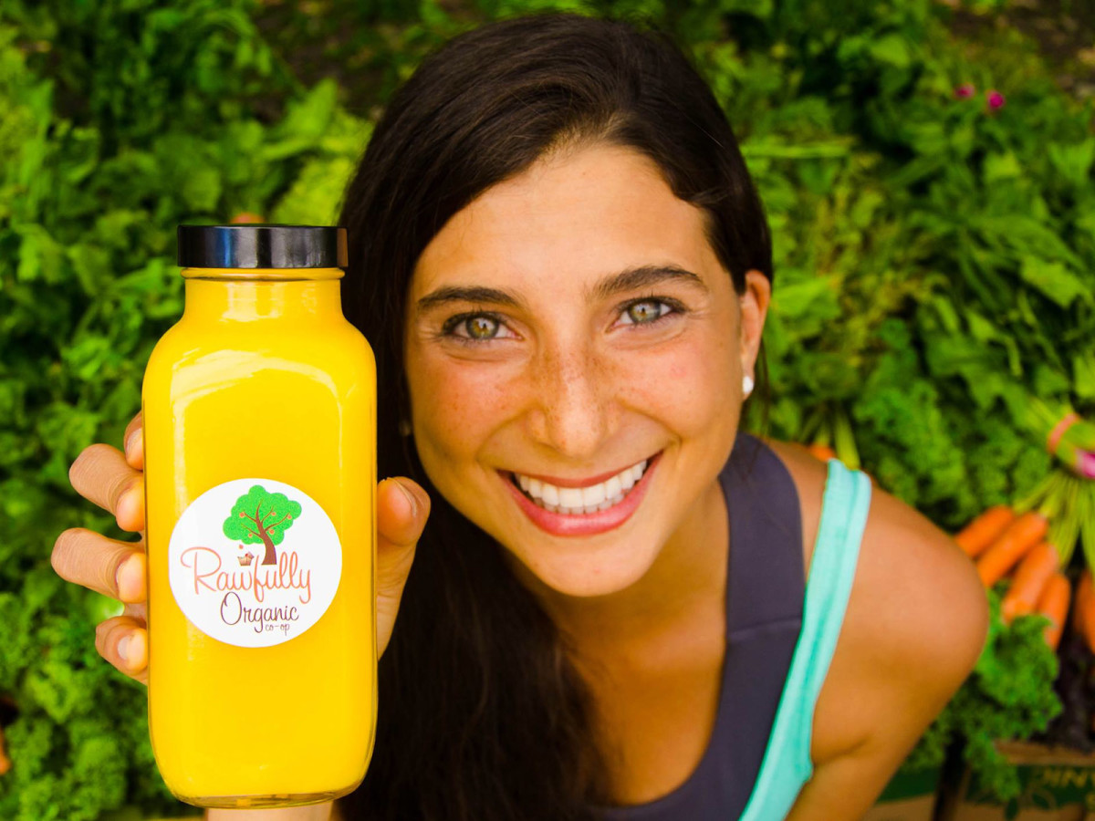 Kristina Carrillo-Bucaram is FullyRaw Rawfully Organic Co-op organge juice head shot May 2013