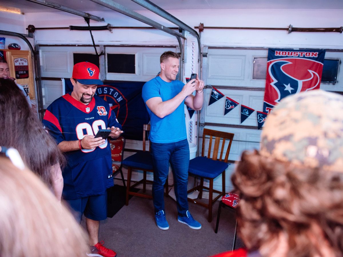 J.J. Watt delivers pizza checks out man cave of Wayne Lominac