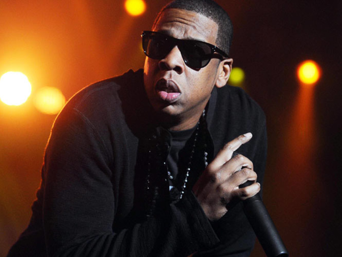 Jay-Z, with mic, sunglasses