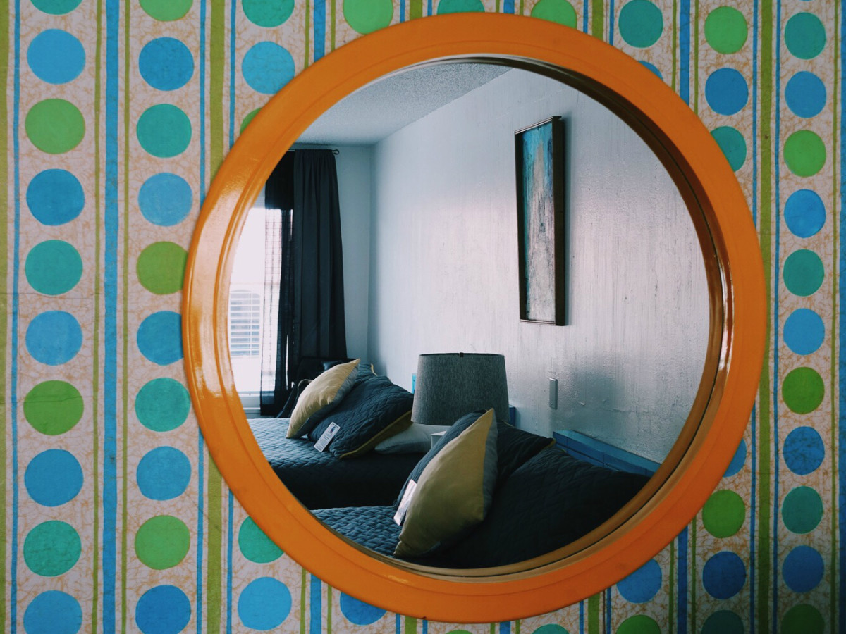 Austin Motel South Congress hotel Bunkhouse guest room mirror beds