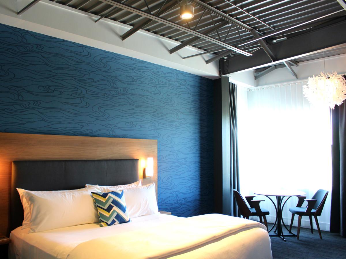 Hotel Eleven 11th Street Austin 2016 guest bedroom large blue window