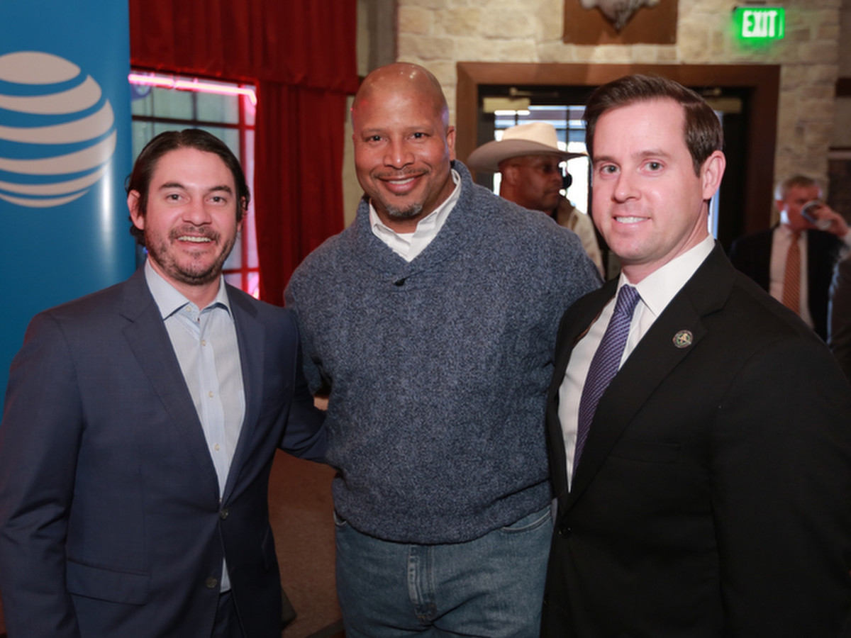 : Joshua Sanders, unidentifed, Chris Brown at Mayor's Rodeo Kickoff Breakfast