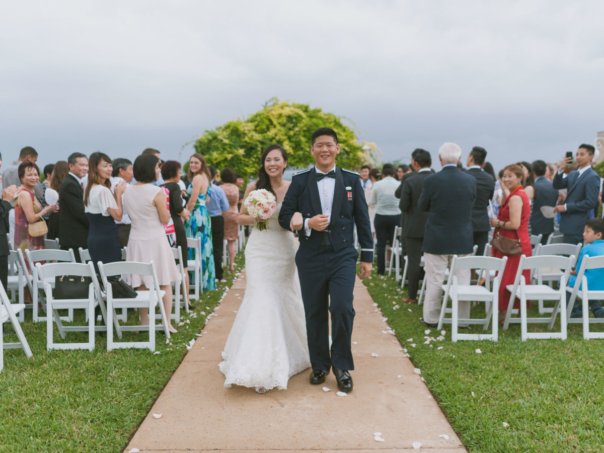 Pauline and Dayle Chang walking down aisle
