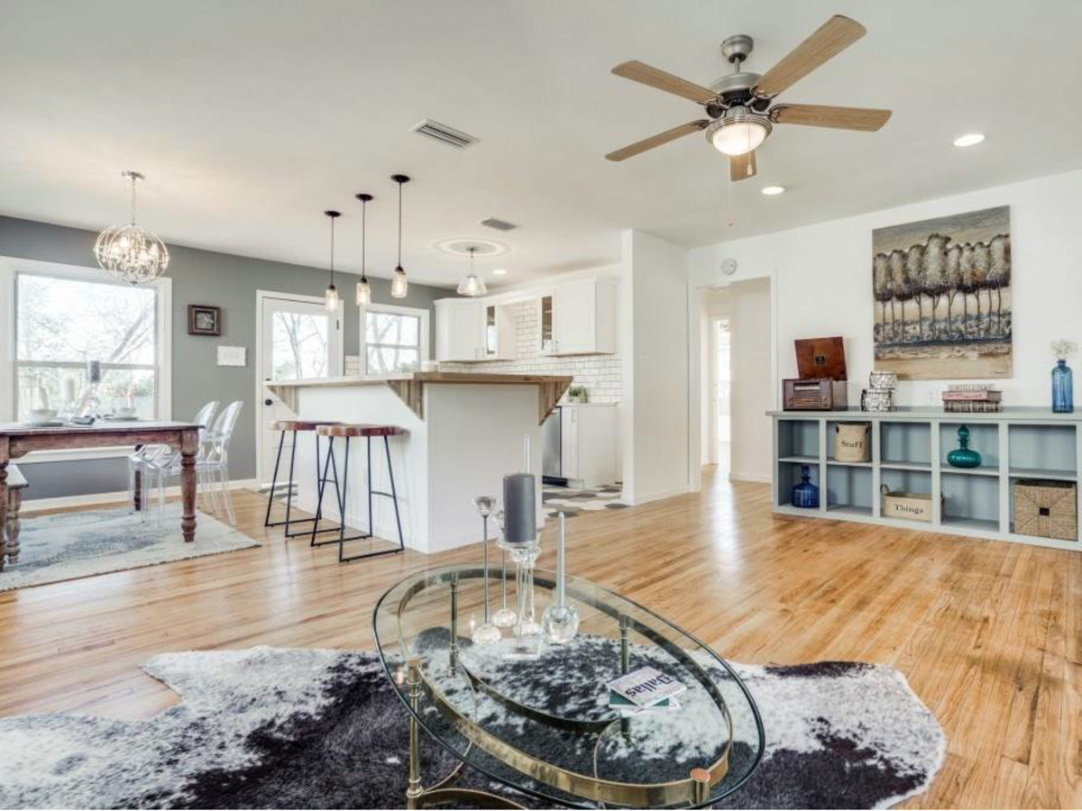 Living room and kitchen at 9014 Daytonia Ave. in Dallas