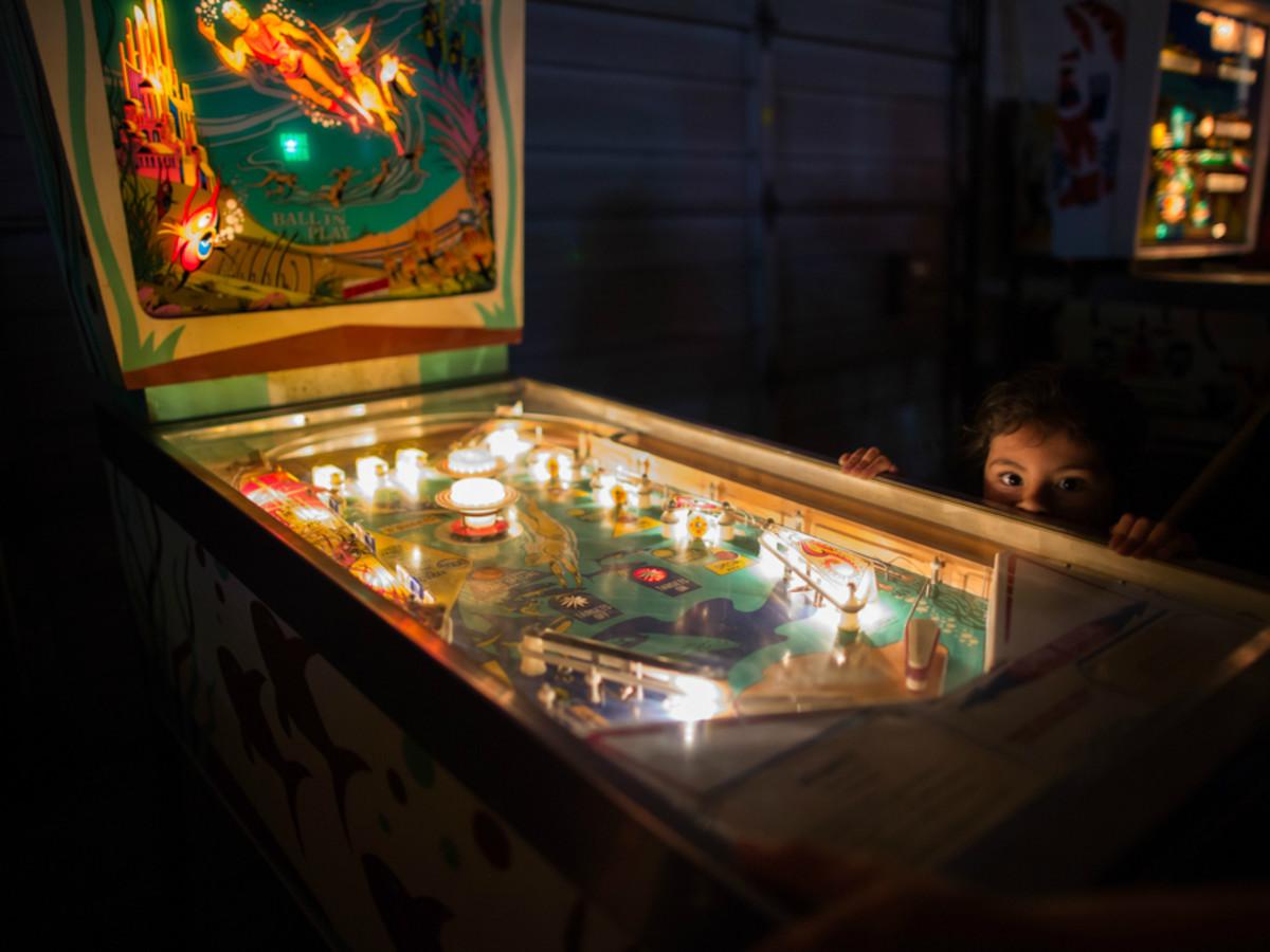 Humans of San Antonio Michael Cirlos photography project kid pinball machine