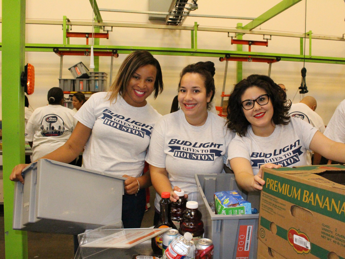 News, Shelby, Silver Eagle Distributors at Food Bank, July 2015 , Misty Buard, Ruth Contreras, Jamie Glavan