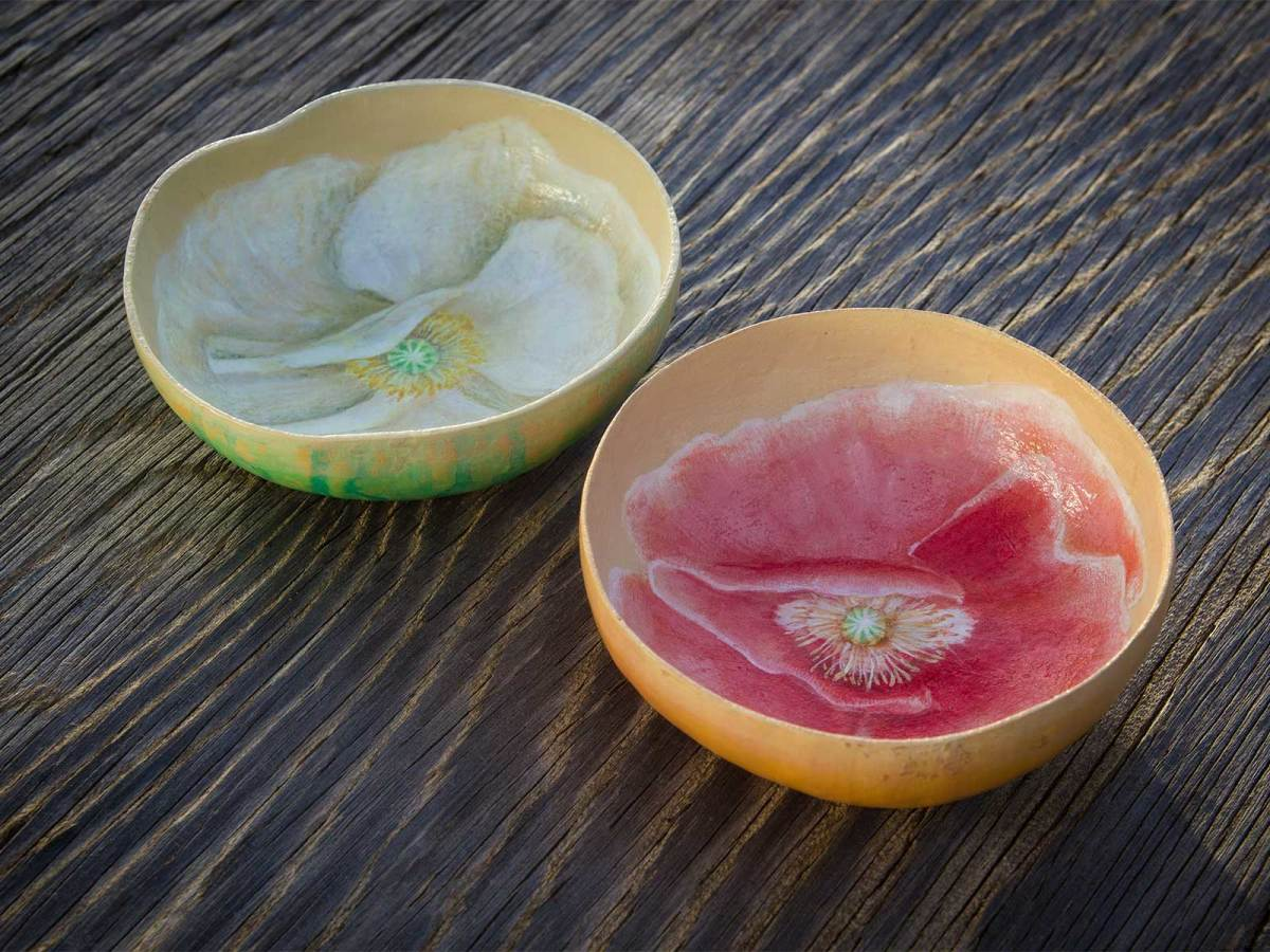 Photo of painted bowls made of gourds
