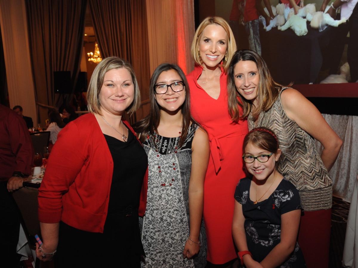 The Nieto family, Ilona Carson, Tiffany Travis at Go Red for Women luncheon
