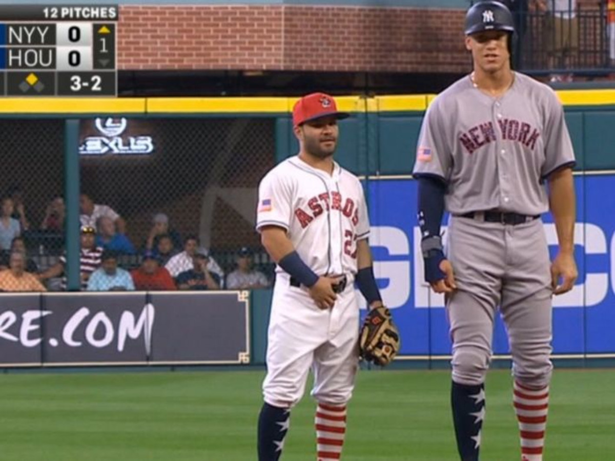 Joseph Altuve, Aaron Judge standing next to each other