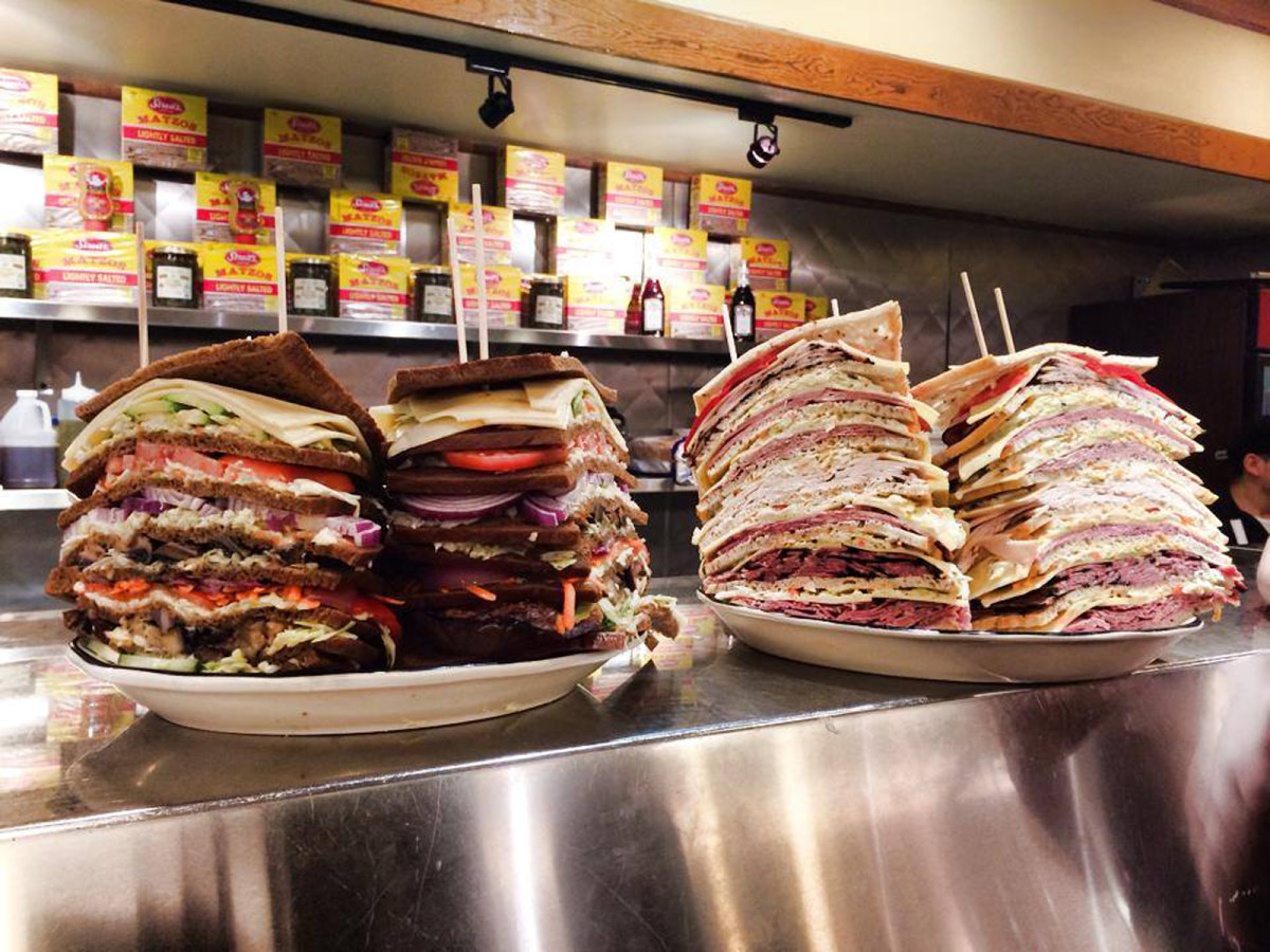 Kenny & Ziggy's giant deli sandwiches on counter