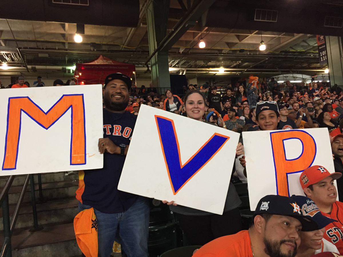 (Altuve) MVP sign held by Andrew Callis, Wendy Callis, Collin Callis hold an Altuve MVP sign at Minute Maid Park Game 7 World Series watch party