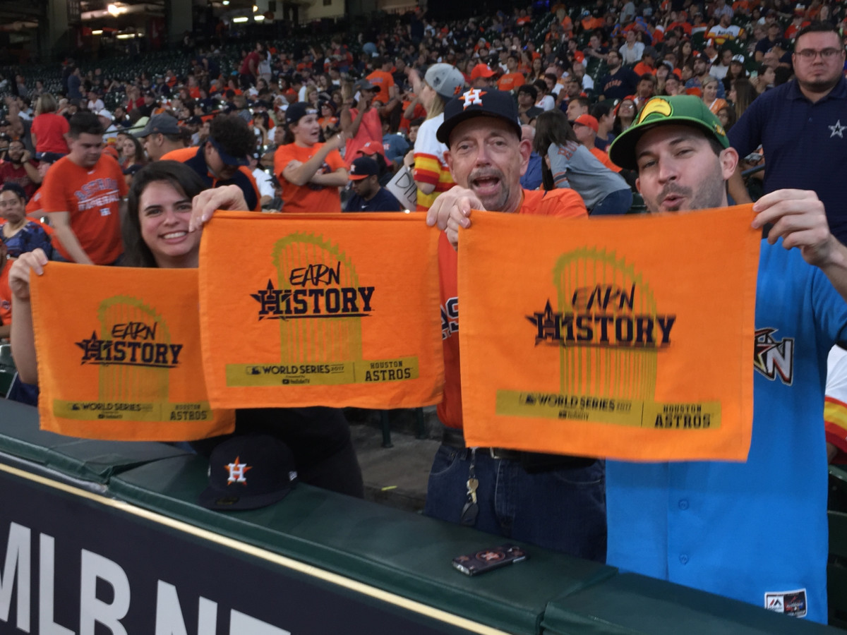 Holding orange towels- Stefanie Schneider, Larry Ness, Chris Glaser at World Series 7 watch party at Minute Maid Park