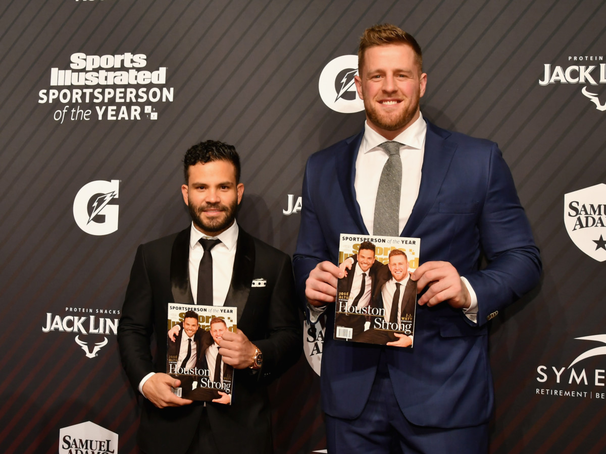 JJ Watt and Jose Altuve holding Sports Illustrated covers