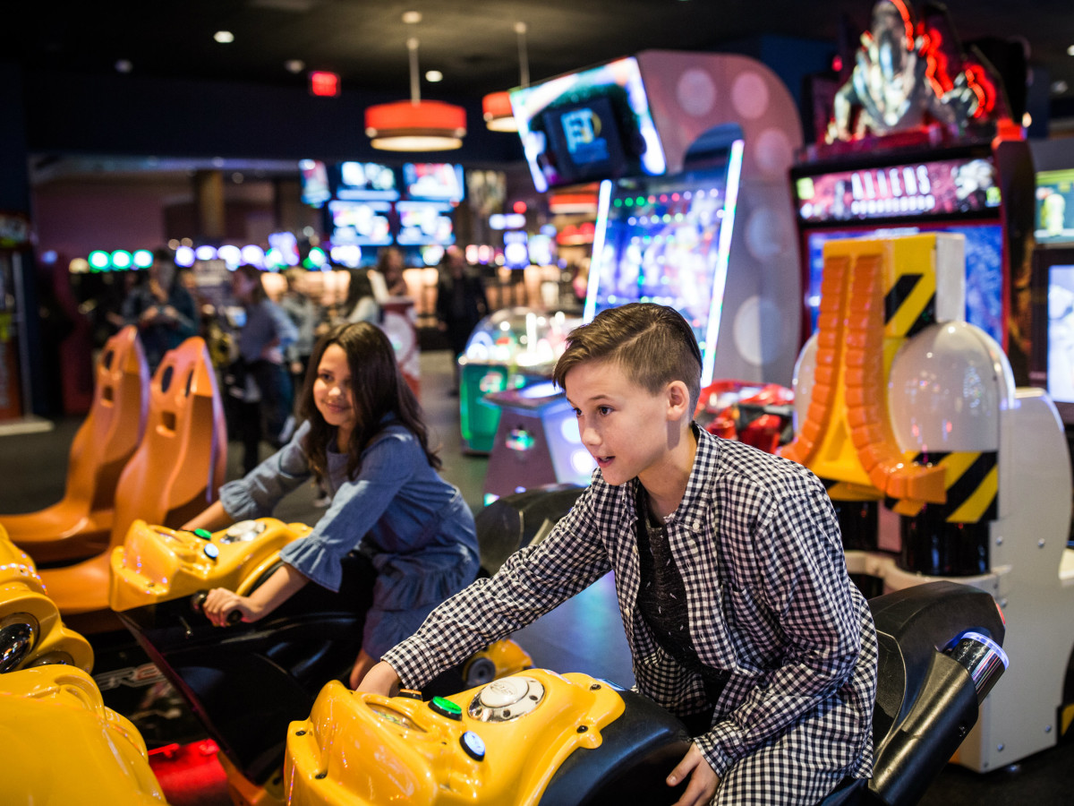 Kids playing arcade games