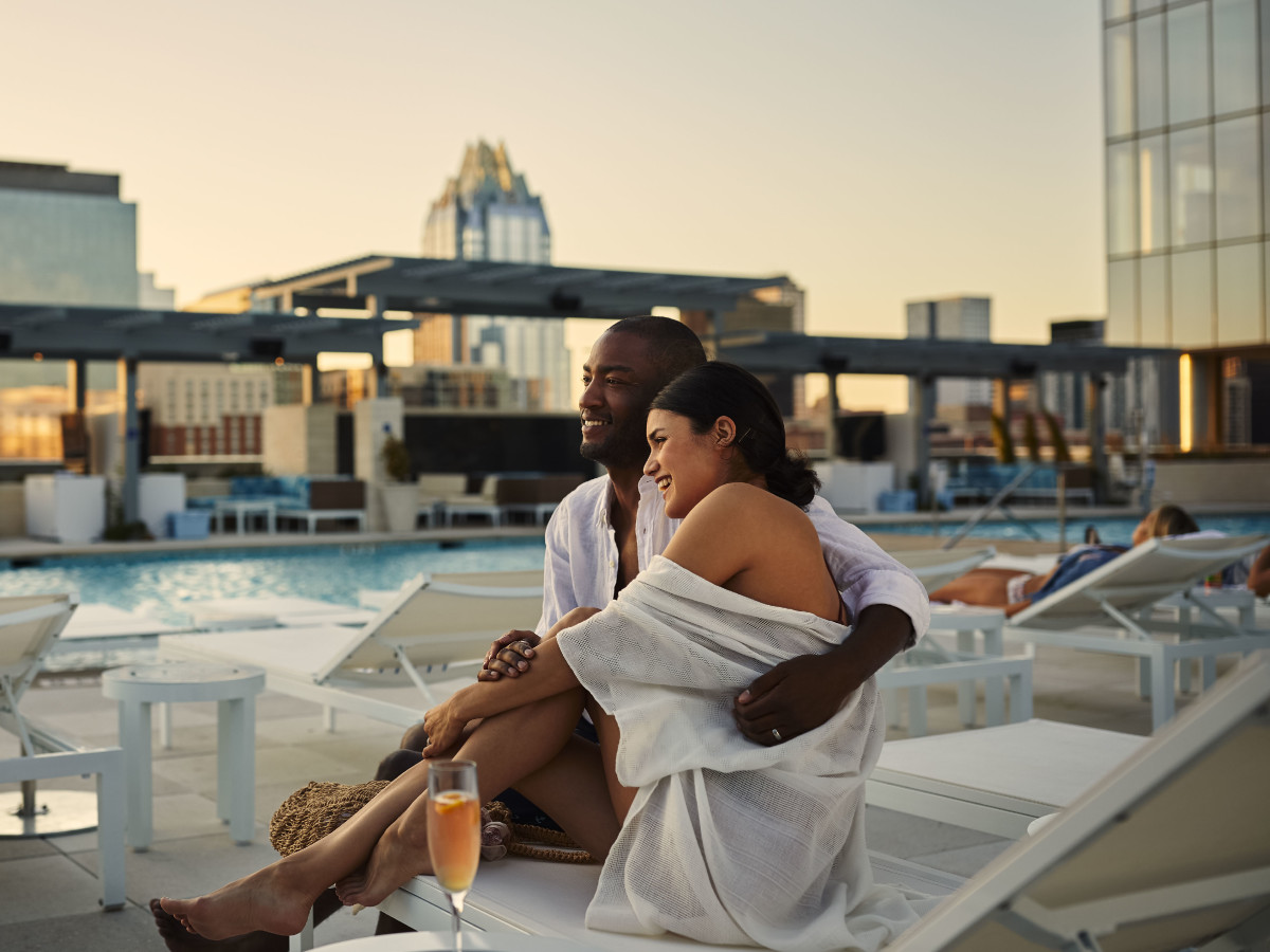 Fairmont Hotel Austin, couple poolside with champagne