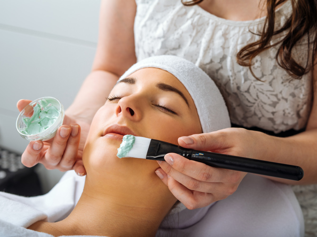 Women receiving a facial