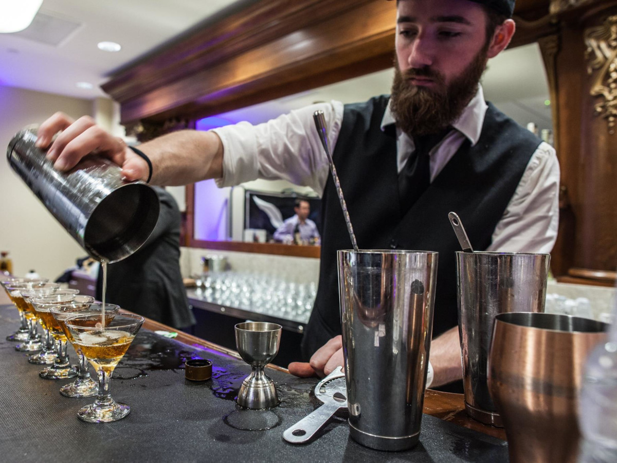 Houston Whiskey Festival bartender pouring