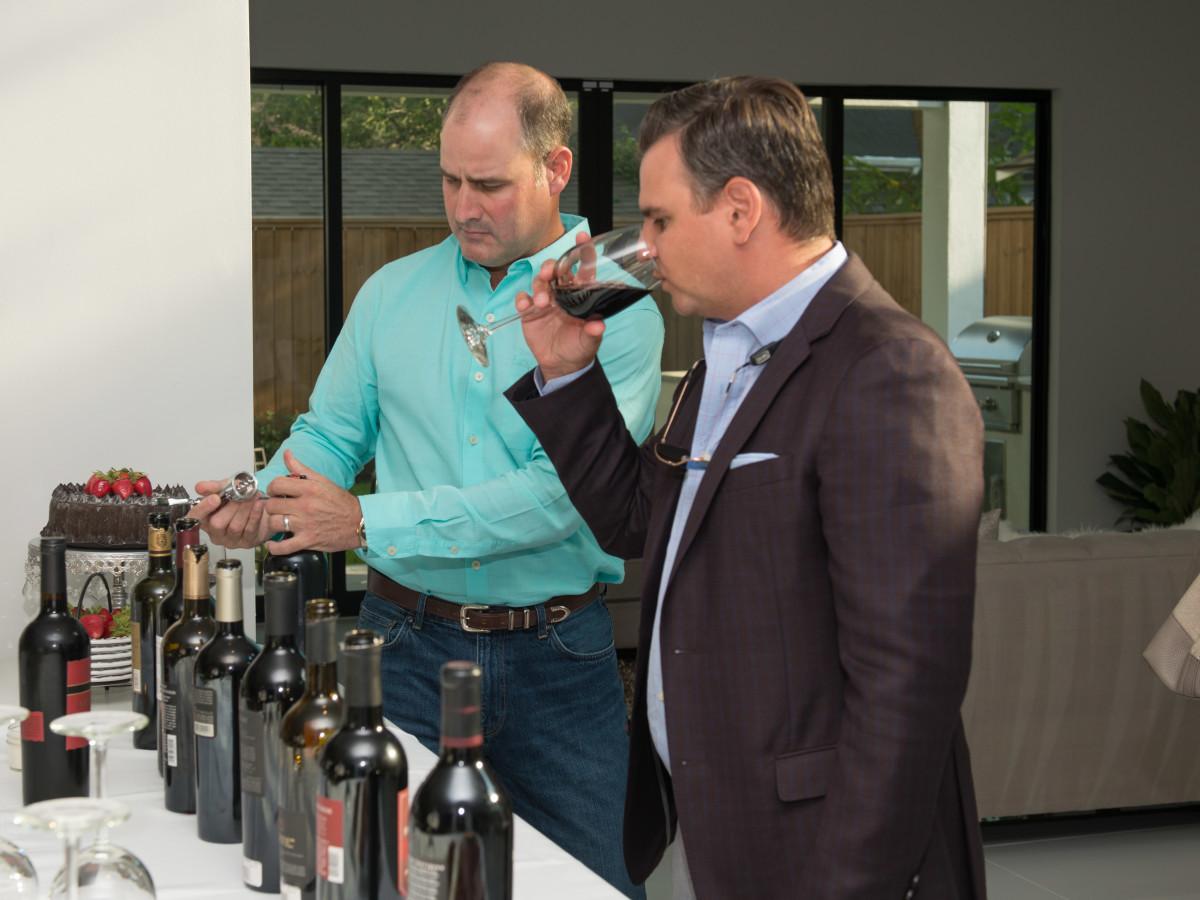 Men tasting wine