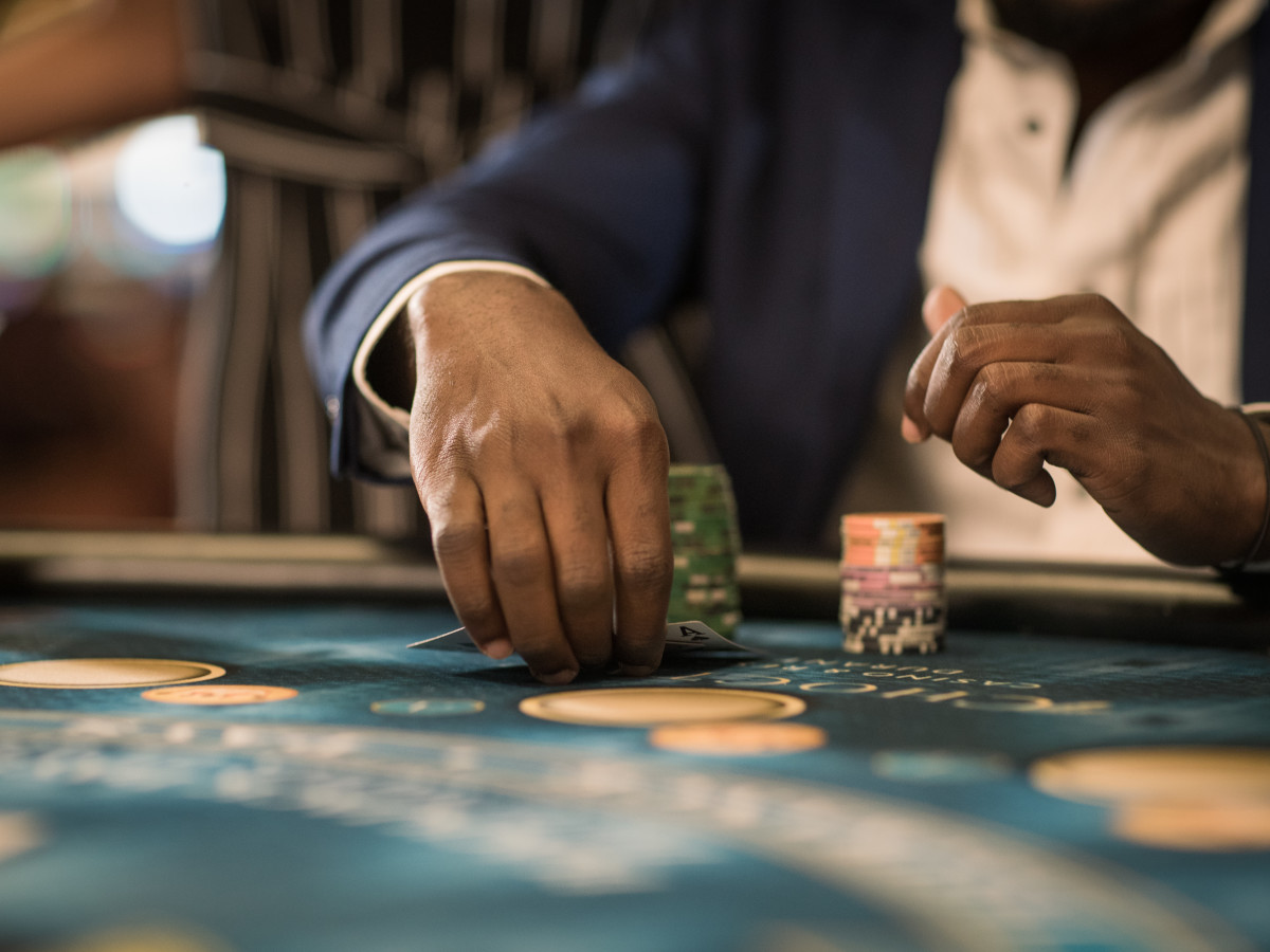 Man playing cards at a casino