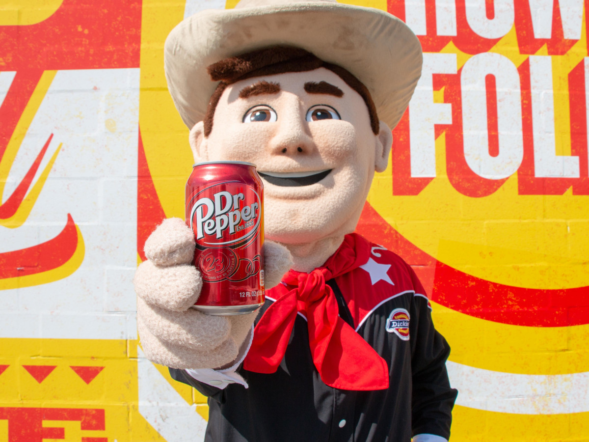 Big Tex holding a Dr Pepper can