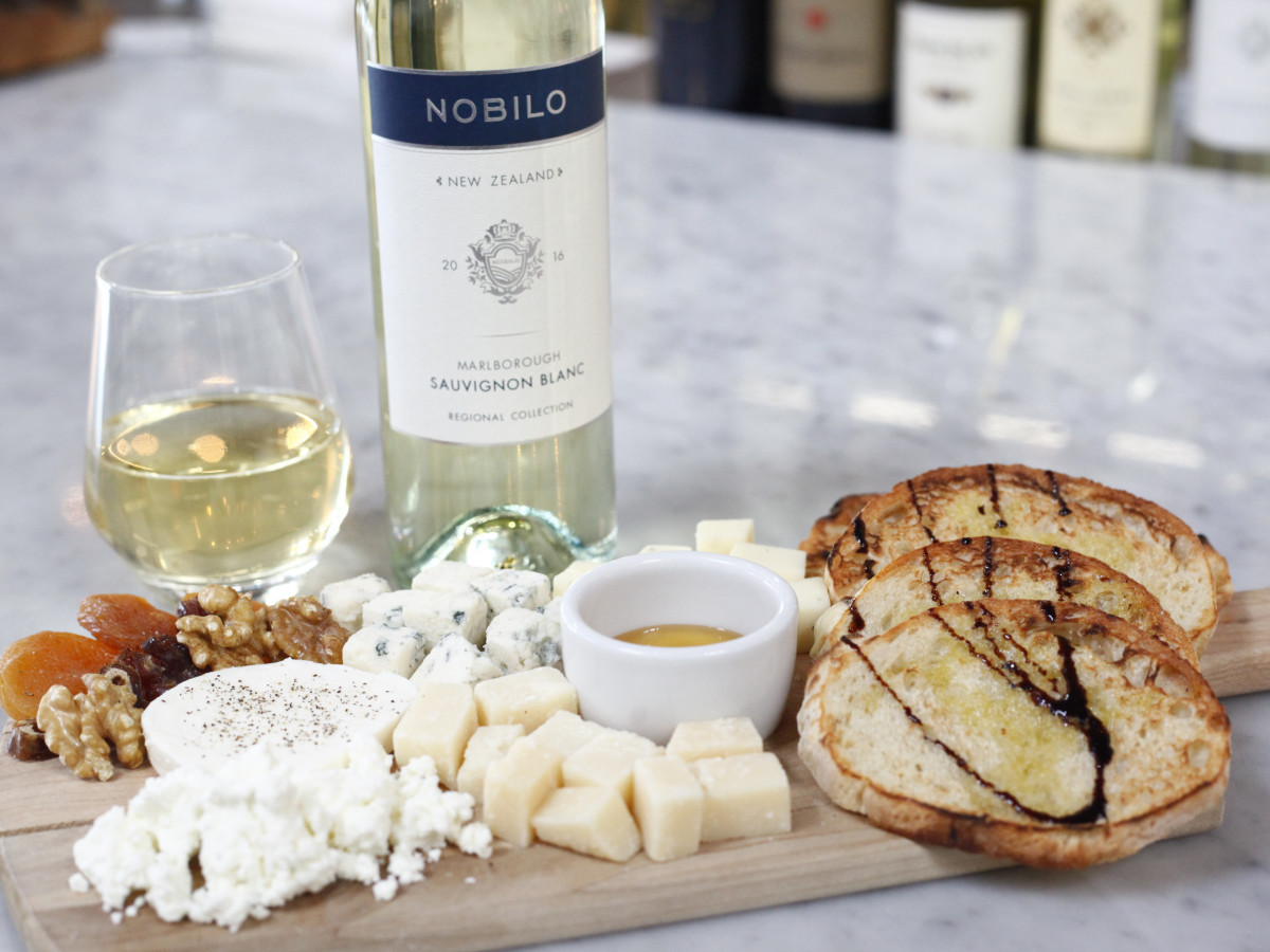 Midici cheese platter and bottle of wine