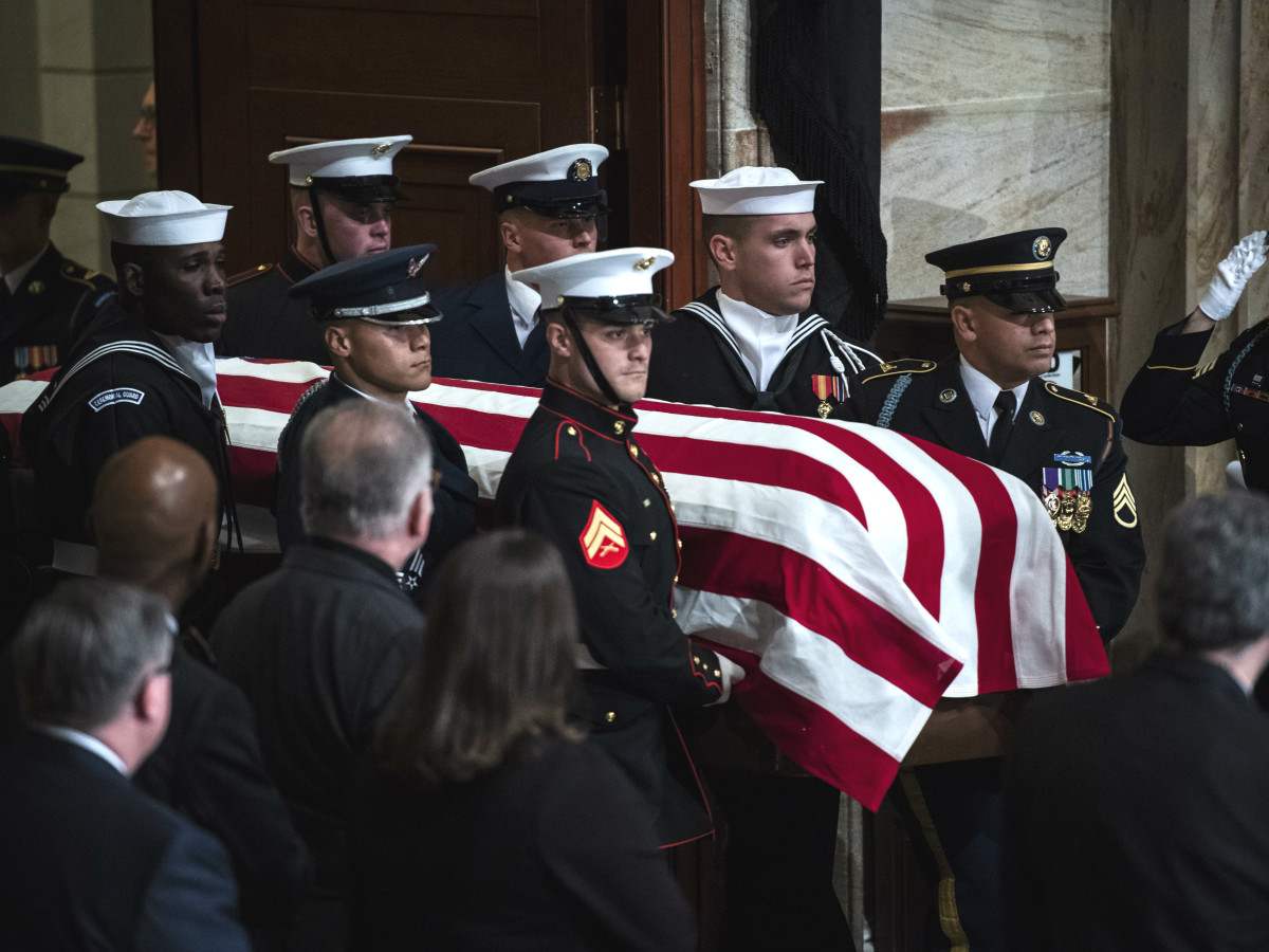 George HW Bush casket soldiers DC arrival remains body funeral