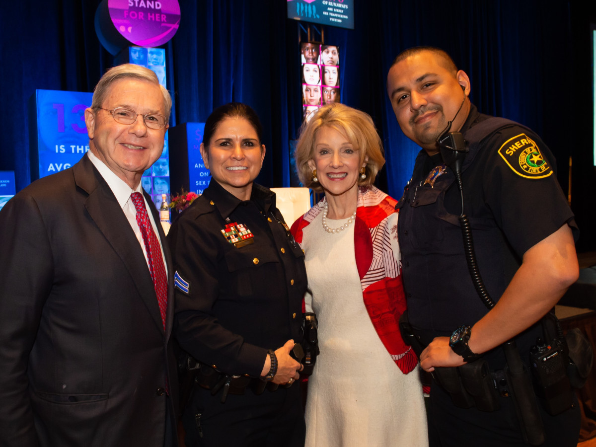 Mike and Marla Boone with Deputy Constable Bertha Rivera Roop, Deputy Sheriff José Sorola