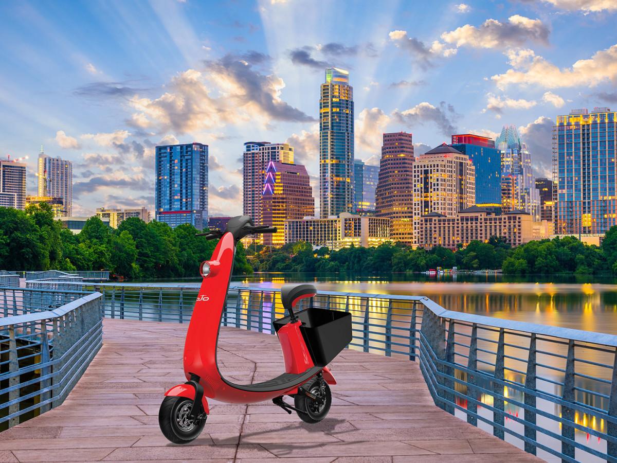 Ojo electric sit-down scooter Austin skyline