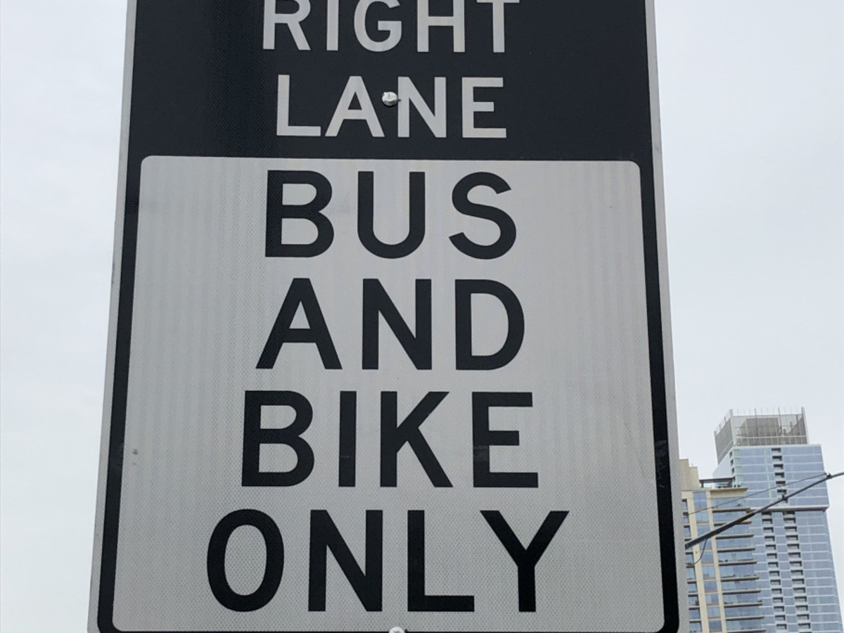 Bus bike lane sign