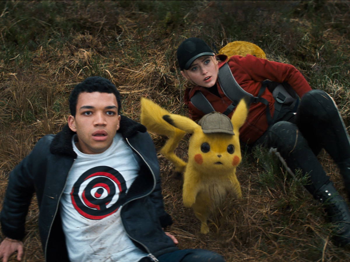 Justice Smith, Pikachu (Ryan Reynolds), and Kathryn Newton in Pokémon Detective Pikachu
